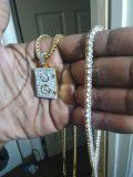 2 very nice chains one choker dtyle mens and one with safe charm that opens for Sale in Cleveland, OH