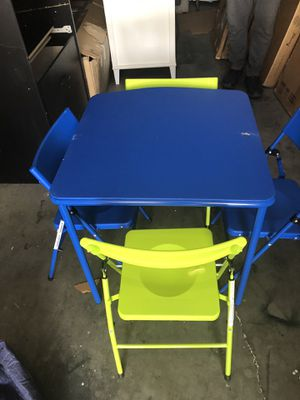 Folding Kids table with 4 chairs / new never used for Sale in Las Vegas, NV