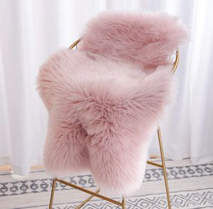 Brand new Sheepskin Chair Cover Seat Cushion, Modern Imitation Sheepskin Plush Carpets Fluffy Shaggy Area Rugs for Bedroom Living Room Home Decor 2 x for Sale in Lake Oswego, OR