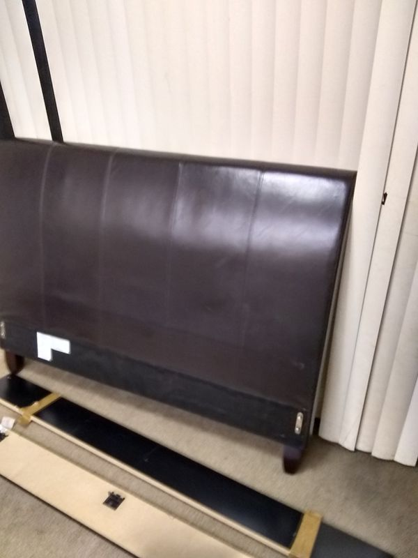 Beautiful queen size dark brown headboard with matching leather side rails and in peace all pieces included in good condition