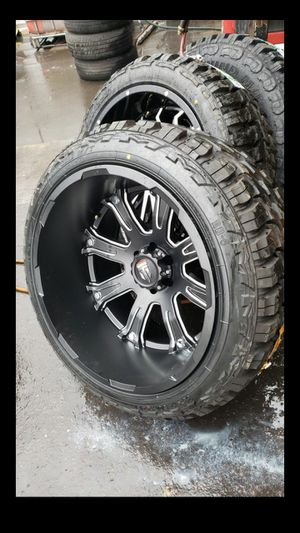 Black friday especial only one set 22x14 black rims 6 lug 6x135 whit New MUD tires 33 1250 22 for Sale in Phoenix, AZ
