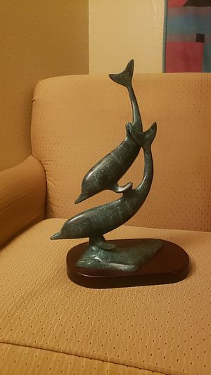 Unmarked solid bronze dolphins swimming silhouette for Sale in Glendale, AZ