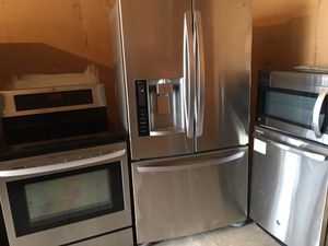 Beautiful stainless steel set LG fridge stove microwave GE dishwasher for Sale in Winter Park, FL