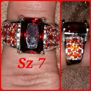 Beautiful sterling silver band w/tons of lab Ruby's. Sz 7&8 available for Sale in Glen Burnie, MD