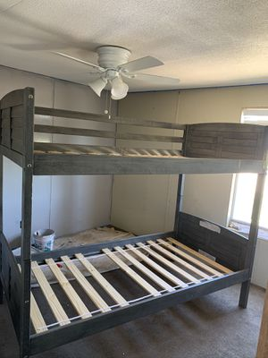 Grey wood twin over twin bunk bed for Sale in Dripping Springs, TX