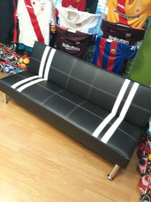 Black futon leather sofa with white stripe for Sale in Los Angeles, CA