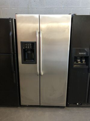 36by69 GE FRIDGE SIDE BY SIDE STAINLESS STEEL WITH WARRANTY for Sale in Woodbridge, VA
