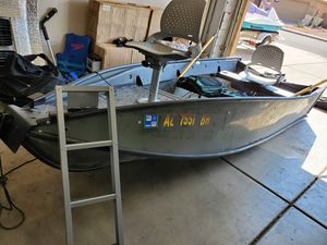 2004 Porta Bote 12ft foldable fishing boat with Nissan 4-stroke 6hp outboard motor for Sale in Glendale, AZ