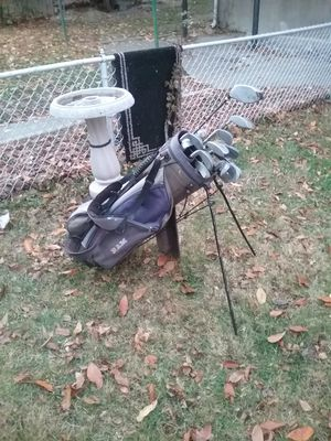 Assorted golf clubs and caddy for Sale in Baltimore, MD