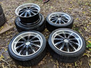 """20"""" wheels and tires multi lug pattern for Sale in Wichita, KS"""