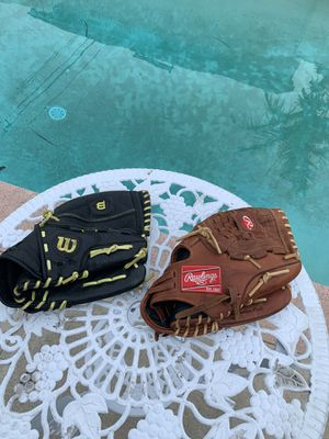 SOFTBALL 🥎 🥎🥎🥎🥎GLOVES 50 FIRM FOR BOTH DONT CONTACT ME UNLESS READY TO BUY THEM THANK YOU for Sale in Whittier, CA