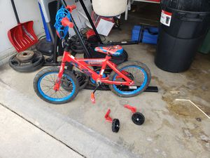 SpiderMan bike for 3 to 5yr old boy. Missing two lug nuts to connect the training wheels. I can and will get new ones if needed. for Sale in Bloomington, IL