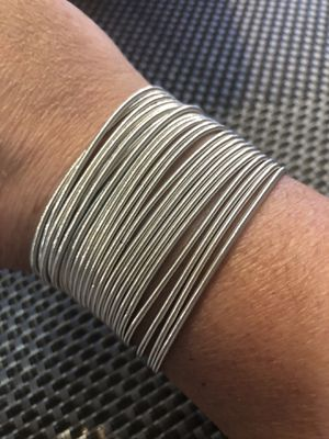 Set of 12 Stainless steel string guitar bracelets. Available in silver tone, gold tone, and grey tone. Set of 12 for $20.00 for Sale in Hialeah, FL