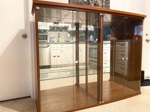 Large Display cabinet with glass doors and shelves. for Sale in Oakland Park, FL