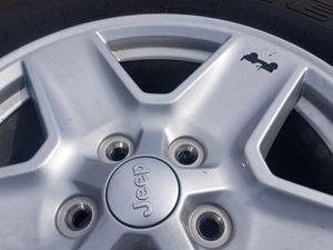 4 New takeoffs Jeep wrangler wheels/tires 17 inches for Sale in Auburndale, FL