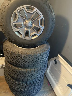 """Set of 5 wheels and tires for jeep rubicon 2015. Factory rings 17"""" with off road tires for Sale in La Vergne, TN"""