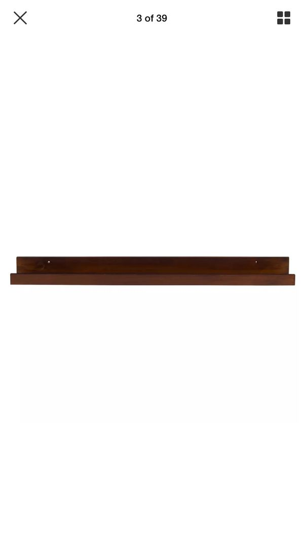 Kate and Laurel Levie wood floating wall shelf