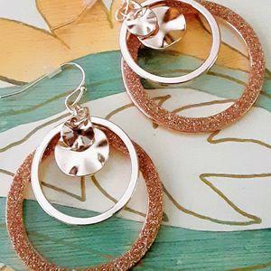 New goldtone multi-ring hoop dangle earrings for Sale in Fullerton, CA