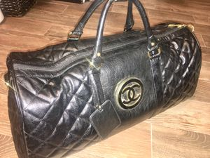 BLACK LEATHER QUILTED CHANEL DUFFLE BAG WITH LOGO ON THE SIDE for Sale in Atlanta, GA