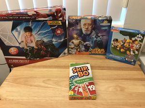3 never opened puzzles & card game for Sale in South Miami, FL
