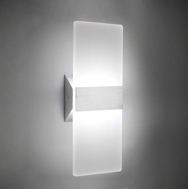 Brand new (still in packaging) beautiful, wired wall sconce light in silver finish