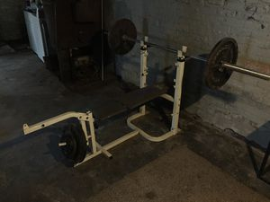 Weight bench with bar and weights for Sale in Detroit, MI