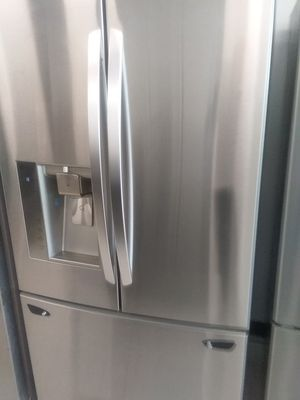 Lg French doors stainless steel refrigerator used good condition 90days warranty for Sale in Mount Rainier, MD