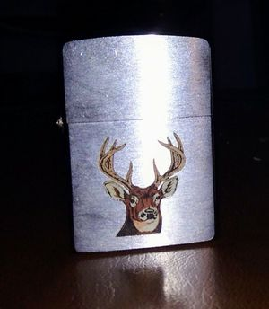 Vintage 1990 8 point buck Zippo lighter for Sale in Louisville, KY