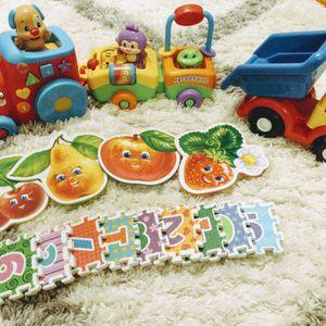 Toddler toys:Fisher Price musical train, MegaBloks truck, soft puzzles for Sale in Alpharetta, GA