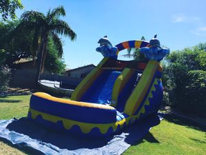 Blue waterslide dolphin inflatable for Sale in Phoenix, AZ