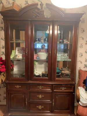 China cabinet with light looks good Moving sale for Sale in Alexandria, VA
