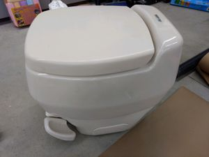 * RV Porcelain toilet by Thetford for Sale in Desert Aire, WA