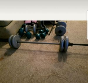 4 14.5 lb. Plates with bar curl bars too for Sale in Forest Hill, MD