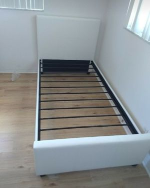 Twin size bed frame and free delivery New in the box for Sale in Hialeah, FL