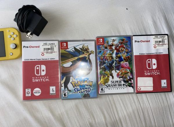 Nintendo Switch Lite (Yellow) with 4 games, Lego Marvel SH 2, Pokemon Sword, Super Smash Bro's Ultimate, Pokken Tournament Dx