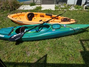 Two used kyaks with paddles and life vests $250 for Sale in Celebration, FL