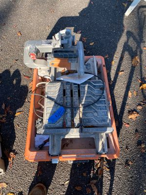"Rigid R4040 tile wet saw. 8"" blade with adjustable Stand New motor. Works excellent. for Sale in Sewell, NJ"