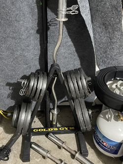 Weight set with Curling Bar Dumb Bells Great shape just needs to be wiped up been sitting in the garage for Sale in Pompano Beach,  FL
