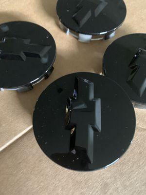 New Chevrolet black center wheel hub caps for Sale in Houston, TX