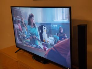 Smart 50 inch vizio tv and ikea yellow tv stand with remote for Sale in Phoenix, AZ