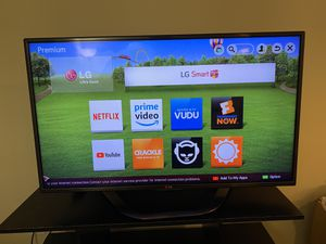 LG Smart TV 42 Inch with TV stand for Sale in Morrisville, NC
