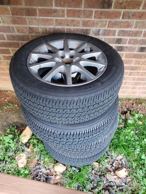 16 inch factory saab wheels with firestone tires for Sale in Raleigh, NC