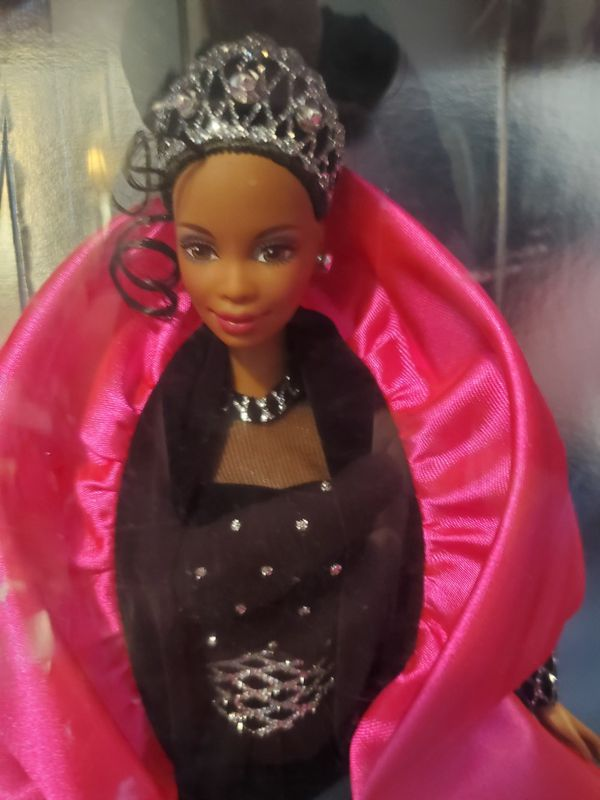 Beautiful Barbie in her black and silver glittery dress with her pink cape