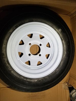 """4-hole 5.30 x 12 12""""White Spoke Trailer rim and Tire 840 lb , 4ply p8 11 for Sale in Silver Spring, PA"""