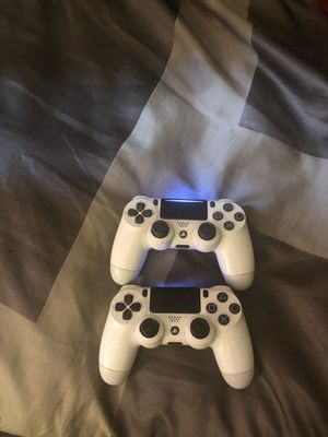 2 White PS4 controllers for Sale in Columbus, OH