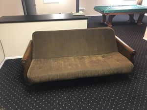 MUST SELL. MAKE AN OFFER. Brown futon with decorative wooden frame for Sale in Deerfield, IL