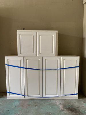 White kitchen cabinets and closet doors for Sale in Tampa, FL