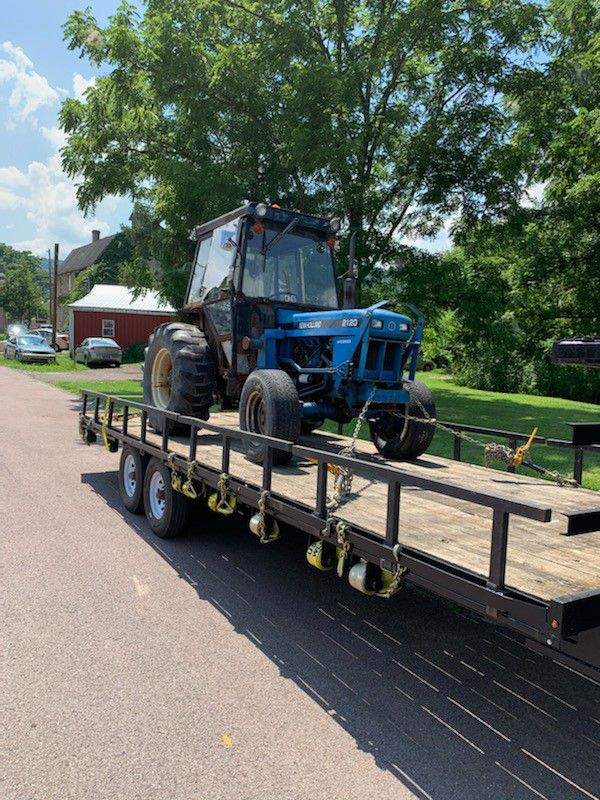 New holland 2120 tractor backhoe and front loader