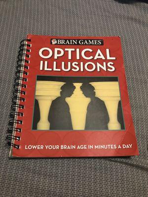 Book full of optical illusions for Sale in San Antonio, TX