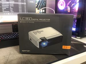 APEMAN MINI PORTABLE PROJECTOR for Sale in Houston, TX